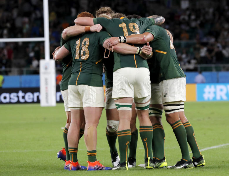 South African players embrace following their Rugby World Cup Pool B game at Shizuoka Stadium Ecopa against Italy, in Shizuoka, Japan, Friday, Oct. 4, 2019. South Africa defeated Italy 49-3. (AP Photo/Shuji Kajiyama)