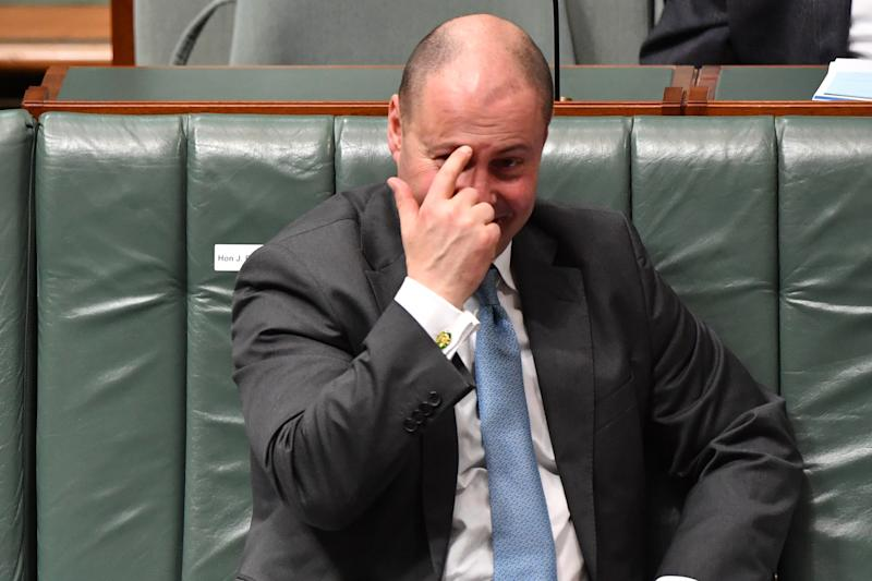 "CANBERRA, AUSTRALIA - AUGUST 26: Treasurer Josh Frydenberg reacts during Question Time in the House of Representatives at Parliament House on August 26, 2020 in Canberra, Australia. The federal aged care royal commission has criticised the Morrison government for failing to establish independent monitoring and reporting of aged care quality outcomes during the pandemic. Prime Minister Morrison acknowledged in the House of Representatives what happened in Victoria was ""not good enough"" insisting the government had a plan to minimise the risk of outbreaks as the performance during the pandemic dominated the first week of federal parliament sitting since June. (Photo by Sam Mooy/Getty Images)"
