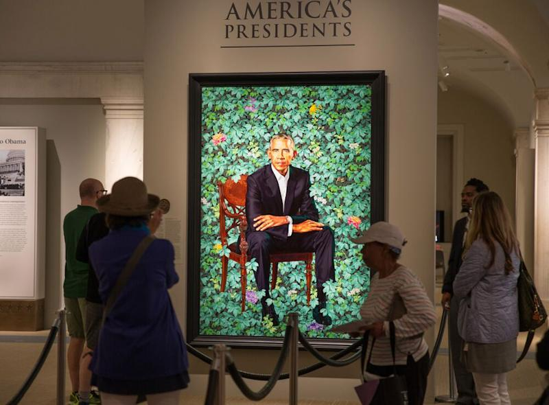 Visitors looking at Kehinde Wiley's portrait of President Barack Obama in June 2018. | George Rose/Getty Images