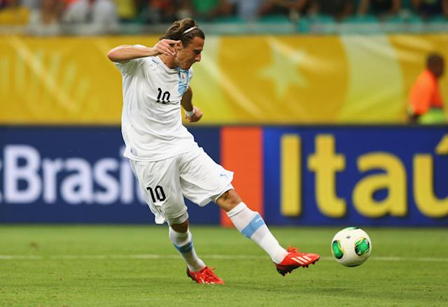 SALVADOR, BRAZIL - JUNE 20: Diego Forlan of Uruguay scores his team's second goal during the FIFA Confederations Cup Brazil 2013 Group B match between Nigeria and Uruguay at Estadio Octavio Mangabeira (Arena Fonte Nova Salvador) on June 20, 2013 in Salvador, Brazil. (Photo by Clive Mason/Getty Images)