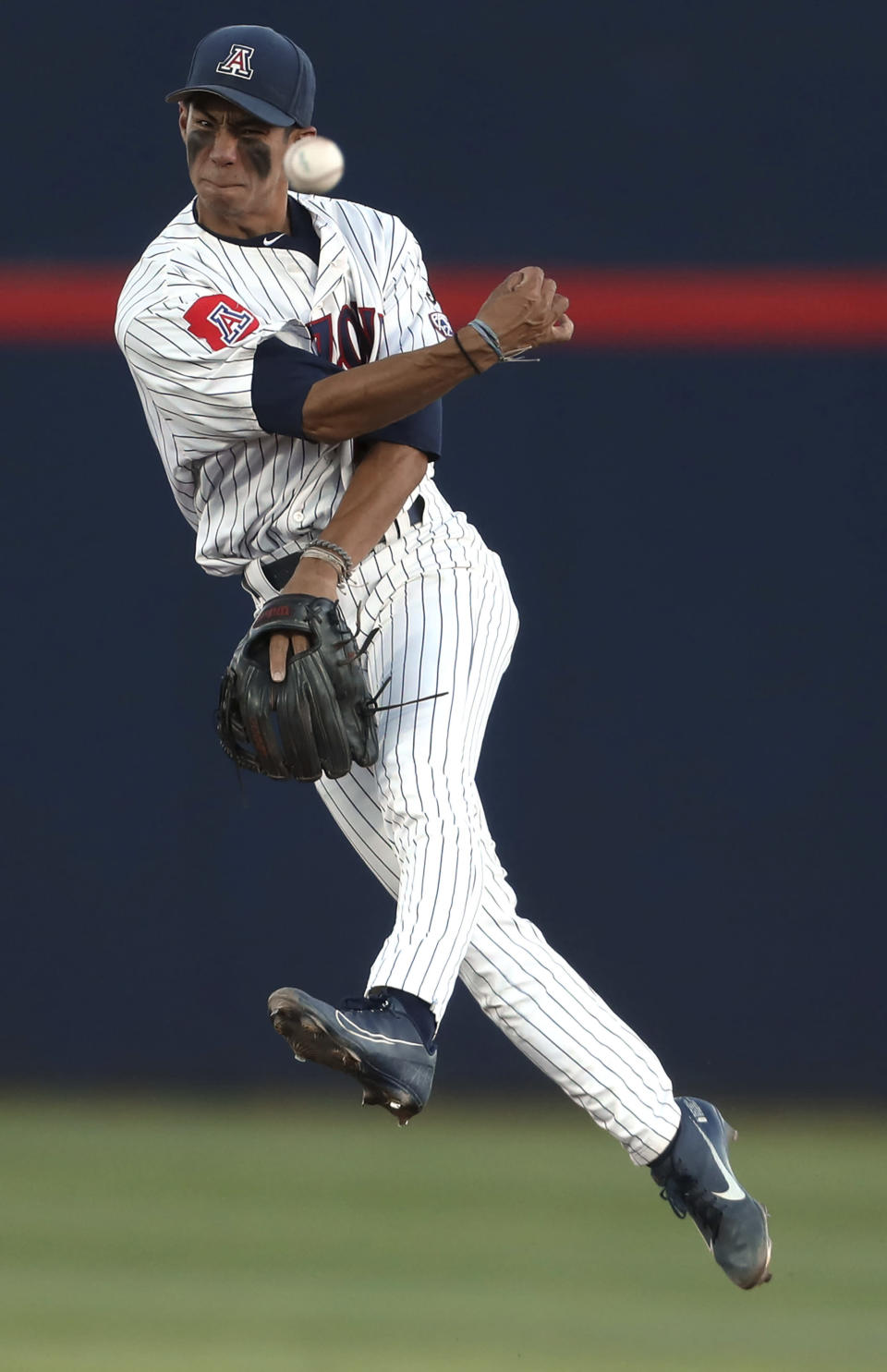 Arizona's Kobe Kato (1) makes the throw to get Mississippi's Jacob Gonzalez during the fourth inning in an NCAA college baseball tournament super regional game Friday, June 11, 2021, in Tucson, Ariz. (Kelly Presnell/Arizona Daily Star via AP)