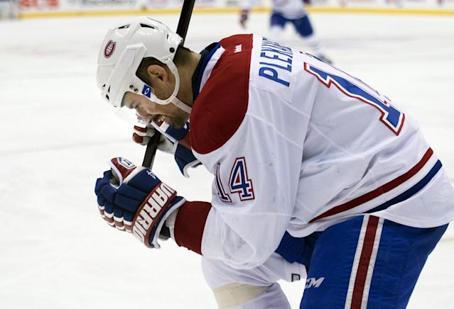 Montreal Canadiens forward Tomas Plekanec celebrates his game-winning goal against the Toronto Maple Leafs during their third period of an NHL hockey game in Toronto on Saturday, March 22, 2014. (AP Photo/The Canadian Press, Nathan Denette)