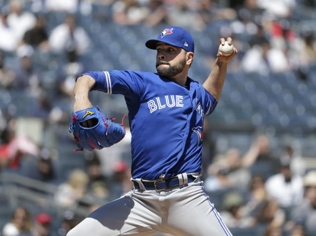 Toronto Blue Jays starting pitcher Jaime Garcia throws during the first inning of the baseball game against the New York Yankees at Yankee Stadium Sunday, April 22, 2018 in New York. (AP Photo/Seth Wenig)