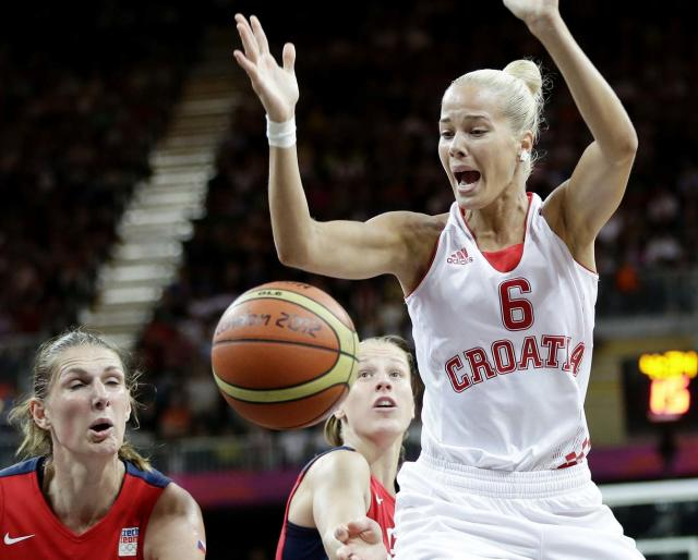 Croatia's Antonija Misura (6) loses control of the ball as Czech Republic's Ilona Burgrova, left, defends during a preliminary women's basketball game at the 2012 Summer Olympics, Wednesday, Aug. 1, 2012, in London. (AP Photo/Eric Gay)