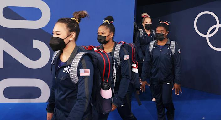 Team USA enter the arena wearing face masks on day two of the Tokyo 2020 Olympic Games at Ariake Gymnastics Centre (Laurence Griffiths / Getty Images)
