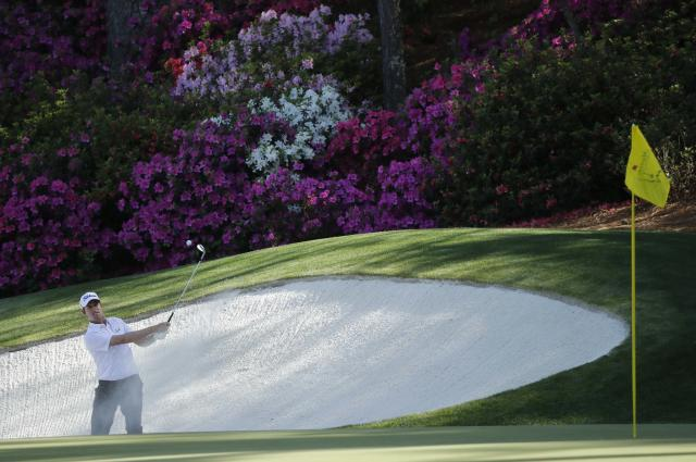 Webb Simpson of the U.S. chips to the 13th green from a sand trap during first round play of the 2018 Masters golf tournament at the Augusta National Golf Club in Augusta, Georgia, U.S., April 5, 2018. REUTERS/Mike Segar