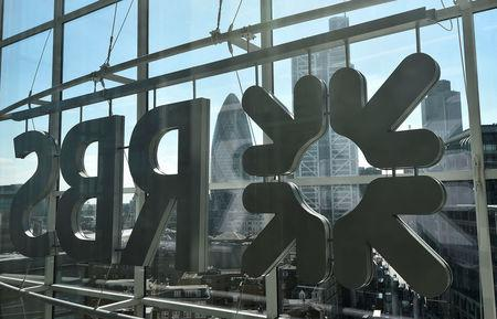 FILE PHOTO: The City of London business district is seen through windows of the Royal Bank of Scotland headquarters in London