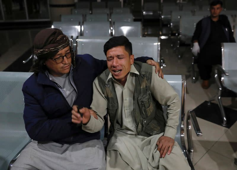 Man who lost his brother mourns at a hospital after a suicide bombing in Kabul