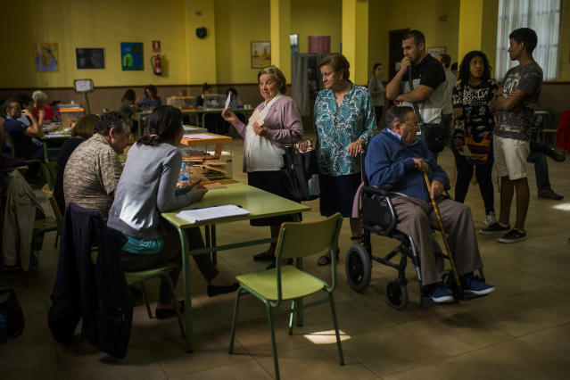 <p>A woman votes at a polling station in Madrid, May 24, 2015. (AP Photo/Andres Kudacki) </p>