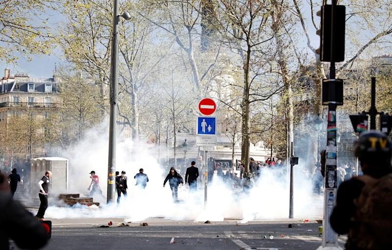 Clouds of tear gas fill the Place de la Republique during clashes between French riot police and members of the Chinese community: REUTERS