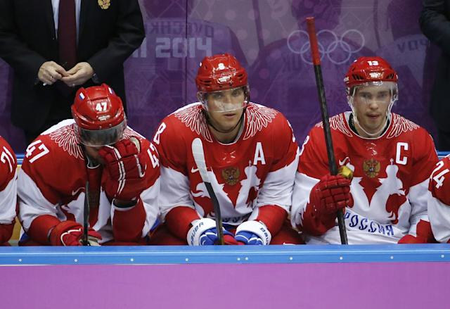 Russia forwards Alexander Radulov, from left, Alexander Ovechkin and Pavel Datsyuk watch play against Finland late in the third period of a men's quarterfinal ice hockey game at the 2014 Winter Olympics, Wednesday, Feb. 19, 2014, in Sochi, Russia
