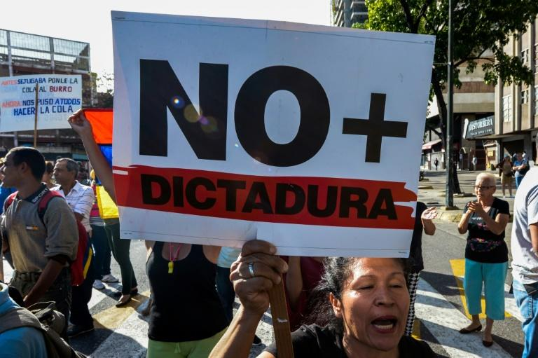 A Venezuelan activist chants slogans against President Nicolas Maduro during an opposition rally in Caracas, on March 31, 2017