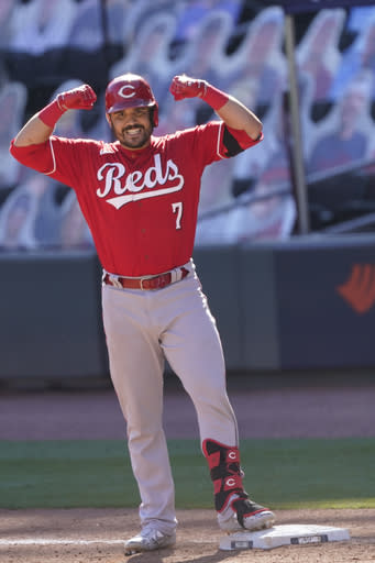 Cincinnati Reds Eugenio Suarez (7) celebrates a base hit in 13th inning against the Atlanta Braves during Game 1 of a National League wild-card baseball series, Wednesday, Sept. 30, 2020, in Atlanta. (AP Photo/John Bazemore)