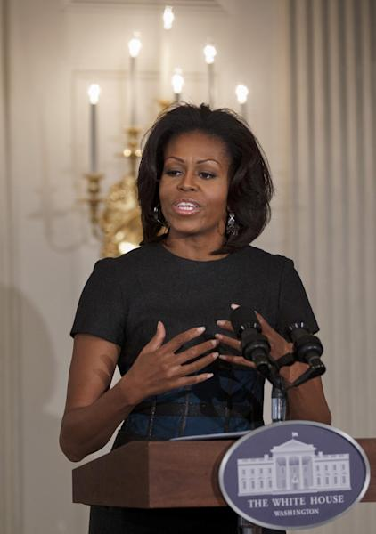 First lady Michelle Obama hosts a student workshop celebrating Blues music in the State Dining Room of the White House in Washington, Tuesday, Feb. 21, 2012. (AP Photo/J. Scott Applewhite)