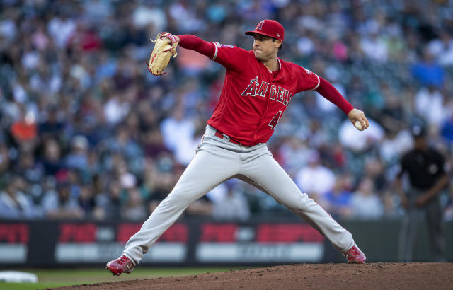 Los Angeles Angels starter Tyler Skaggs throw during the first inning of the team's baseball game against the Seattle Mariners, Friday, May 31, 2019, in Seattle. (AP Photo/Stephen Brashear)