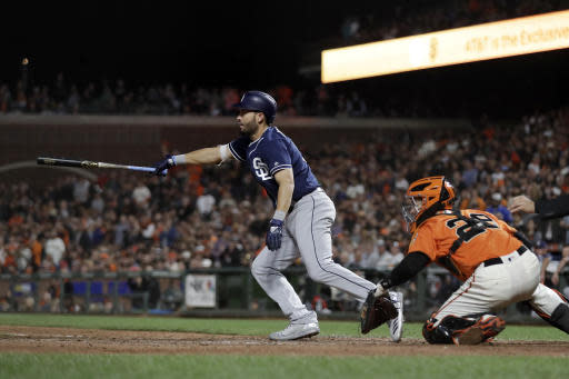 San Diego Padres' Eric Hosmer, left, watches his two-run single against the San Francisco Giants during the ninth inning of a baseball game Friday, June 22, 2018, in San Francisco. (AP Photo/Marcio Jose Sanchez)