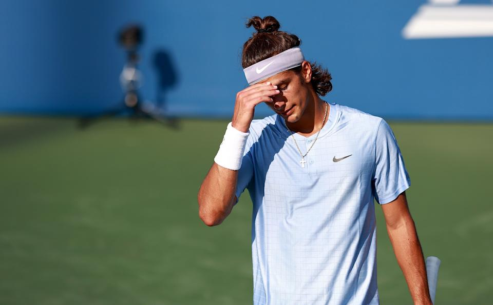 WINSTON SALEM, NORTH CAROLINA - AUGUST 23: Lorenzo Musetti of Italy reacts to a missed shot during his loss to Federico Coria of Argentina on Day 3 of the Winston-Salem Open at Wake Forest Tennis Complex on August 23, 2021 in Winston Salem, North Carolina. (Photo by Grant Halverson/Getty Images)