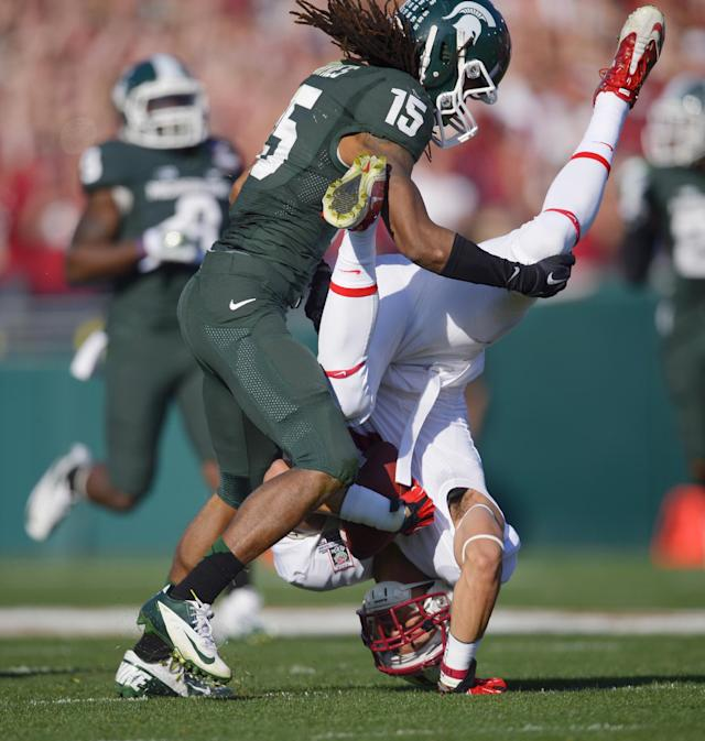 Stanford wide receiver Michael Rector, right, is flipped upside down by Michigan State cornerback Trae Waynes during the first half of the Rose Bowl NCAA college football game Wednesday, Jan. 1, 2014, in Pasadena, Calif. (AP Photo/Mark J. Terrill)
