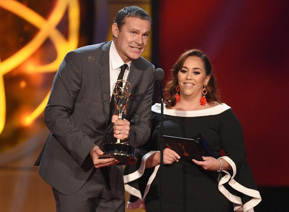 """Alan Tacher and Glicia Marquez-Pronesti accept the award for outstanding morning program in Spanish for """"Despierta America"""" at the 46th annual Daytime Emmy Awards."""
