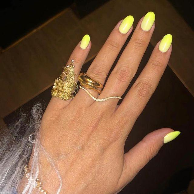 """<p>Nothing showcases a tan more than neon yellow nails and we love the subtle ombre effect.</p><p><a href=""""https://www.instagram.com/p/Bsnsy-EB5De/"""" rel=""""nofollow noopener"""" target=""""_blank"""" data-ylk=""""slk:See the original post on Instagram"""" class=""""link rapid-noclick-resp"""">See the original post on Instagram</a></p>"""