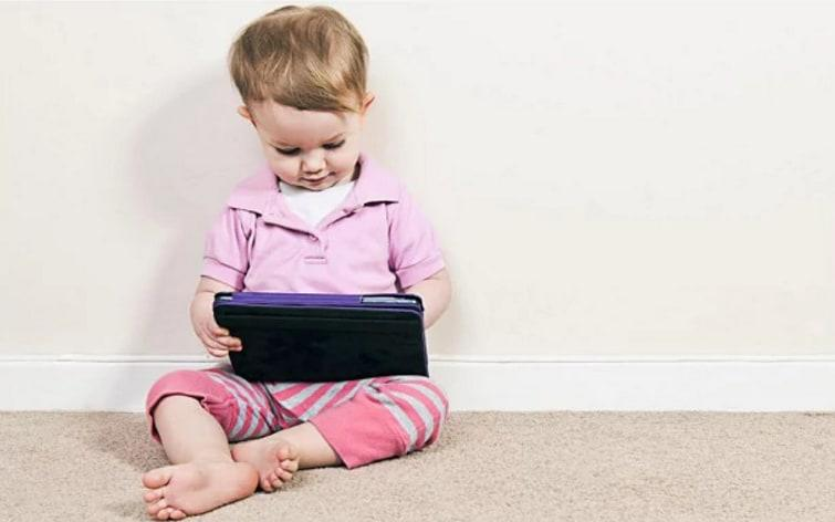 Children under 18 months should not be given handheld devices  - Alamy