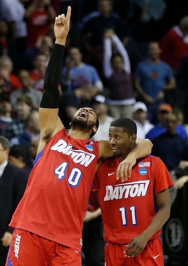 Dayton's Devon Scott (40) and Scoochie Smith (11) celebrate after the second half in a regional semifinal game against Stanford at the NCAA college basketball tournament, Thursday, March 27, 2014, in Memphis, Tenn. Dayton won 82-72. (AP Photo/John Bazemore)