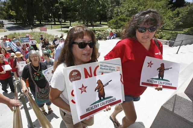 Yolanda Sanchez, left, and her daughter, Michele Sanches-Nelson, a registered nurse, wait in line with other members of the California Nurses Association and supporters to enter the Capitol to call for a single-payer health plan, Wednesday, June 28, 2017, in Sacramento, Calif. (Photo: Rich Pedroncelli/AP)