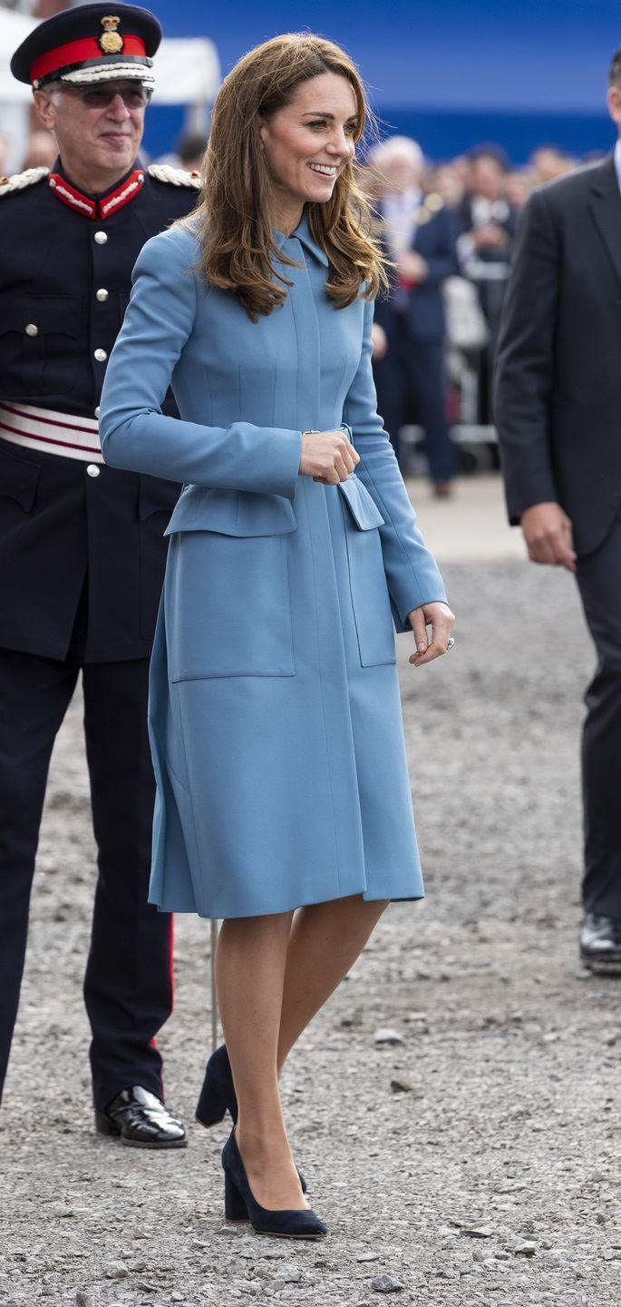 """<p>The Duchess <a href=""""https://www.townandcountrymag.com/style/fashion-trends/a29243564/kate-middleton-alexander-mcqueen-coat-david-attenborough-ship-naming-photos/"""" rel=""""nofollow noopener"""" target=""""_blank"""" data-ylk=""""slk:wore her go-to blue Alexander McQueen coat"""" class=""""link rapid-noclick-resp"""">wore her go-to blue Alexander McQueen coat</a> for the naming ceremony of the RRS Sir David Attenborough, a polar research ship, in Birkenhead.</p>"""
