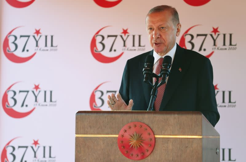 Turkish President Tayyip Erdogan addresses the audience as he attends a ceremony marking the 37th anniversary of the Declaration of Independence of the Turkish Republic of Northern Cyprus in northern Nicosia