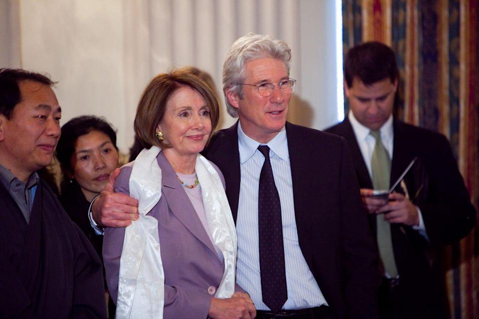 <p>Pelosi and Richard Gere at an event in Washington. </p>
