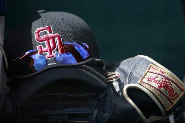 MLB will auction off game-worn Stoneman Douglas caps. (AP Photo)