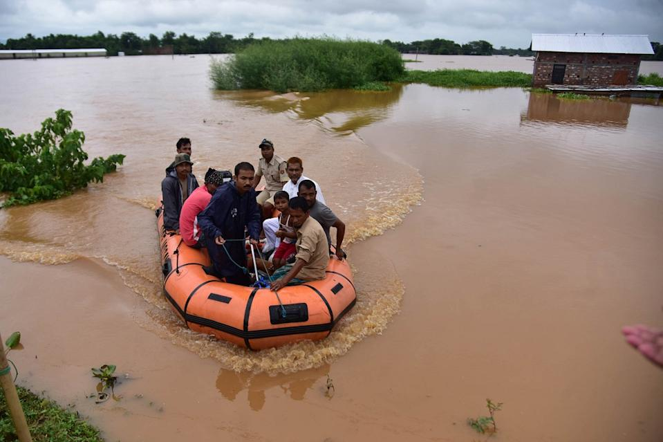 State Disaster Response Force (SDRF) personnel evacuate villagers affected by a flood  at Kachua village in Nagaon district, in the northeastern state of Assam, India,on Sept 26,2020. (Photo by Anuwar Hazarika/NurPhoto)