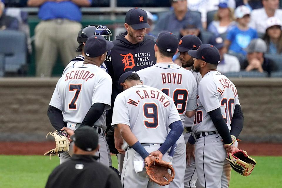 Tigers pitching coach Chris Fetter meets with players on the mound during the fifth inning against the Royals on Saturday, May 22, 2021, in Kansas City, Mo.