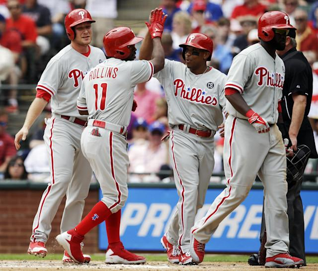Philadelphia Phillies' Jimmy Rollins (11) celebrates after hitting a grand slam home run against the Texas Rangers during the second inning of an opening day baseball game at Globe Life Park, Monday, March 31, 2014, in Arlington, Texas. (AP Photo/Kim Johnson Flodin)