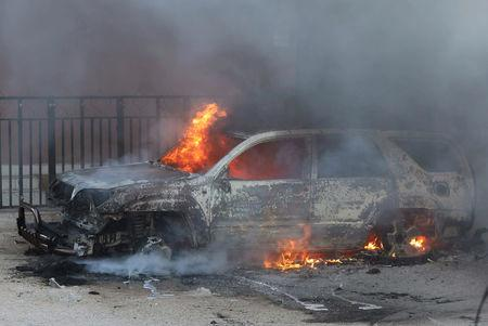A car burns at the scene of an explosion in Mogadishu, Somalia September 22, 2018. REUTERS/Feisal Omar