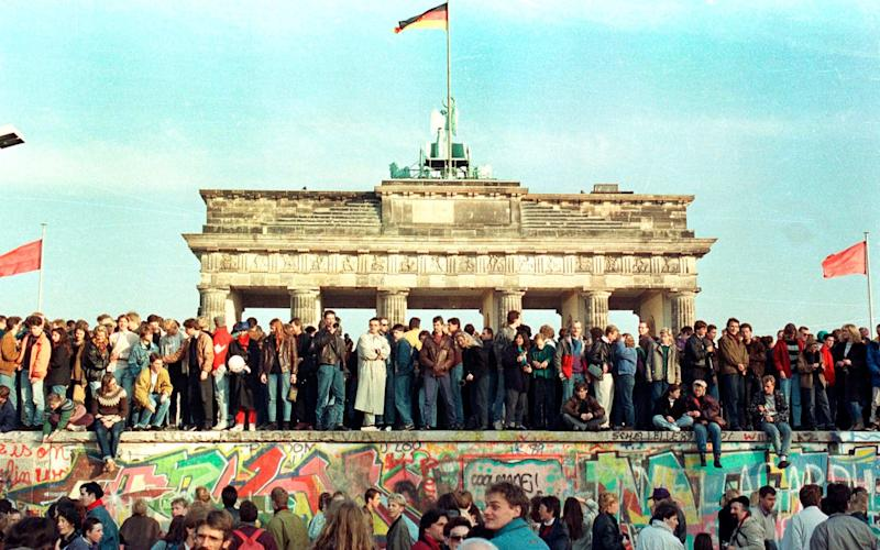 Germans still face a special tax to pay the costs of reunification 30 years after the fall of the Berlin Wall - Reuters
