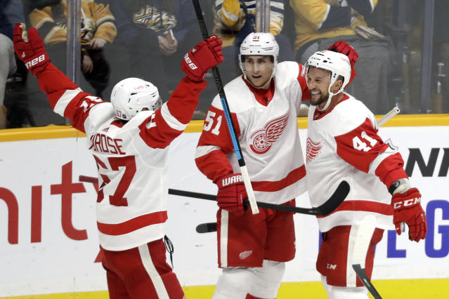 Detroit Red Wings center Luke Glendening (41) celebrates with Valtteri Filppula (51), of Finland, and Taro Hirose (67) after scoring against the Nashville Predators during the third period of an NHL hockey game Saturday, Oct. 5, 2019, in Nashville, Tenn. (AP Photo/Mark Humphrey)