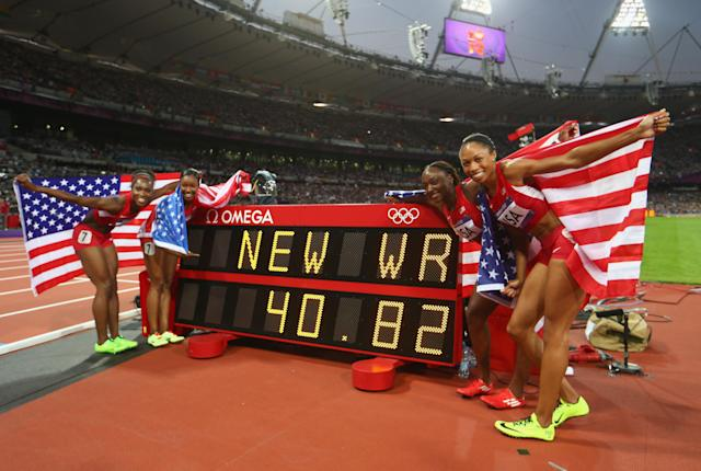Carmelita Jeter of the United States, Bianca Knight of the United States, Allyson Felix of the United States and Tianna Madison of the United States celebrate next to the clock after winning gold and setting a new world record of 40.82 afterthe Women's 4 x 100m Relay Final on Day 14 of the London 2012 Olympic Games at Olympic Stadium on August 10, 2012 in London, England. (Photo by Michael Steele/Getty Images)
