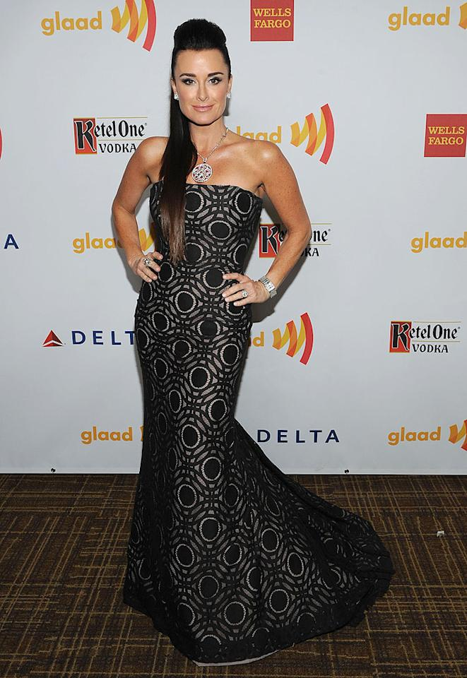 """The Real Housewives of Beverly Hills"" star Kyle Richards sported a dramatic 'do, a statement necklace, and a strapless geometric-print gown by Ines Di Santo for the 23rd Annual GLAAD Media Awards held in Los Angeles. ""Between my earrings pinching my ears and how tight my ponytail is, my head just MAY fall off at the party tonight,"" she tweeted. Do you think the pain was worth it?"