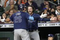 Tampa Bay Rays' Ji-Man Choi (26) celebrates with Brett Phillips after hitting a three-run home run against the Houston Astros during the fifth inning of a baseball game Wednesday, Sept. 29, 2021, in Houston. (AP Photo/David J. Phillip)