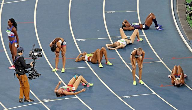 <p>Jessica Ennis-Hill (R) of Great Britain and Brianne Theisen Eaton of Canada react after the Women's Heptathlon 800m on Day 8 of the Rio 2016 Olympic Games at the Olympic Stadium on August 13, 2016 in Rio de Janeiro, Brazil. (Photo by Cameron Spencer/Getty Images) </p>