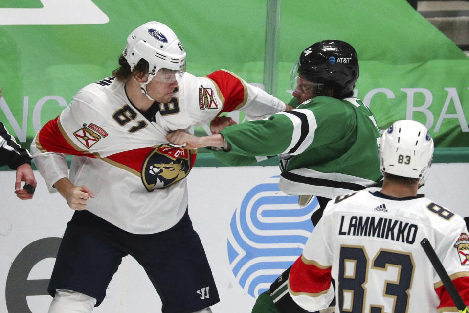 Florida Panthers defenseman Anton Stralman (6) fights Dallas Stars right wing Denis Gurianov (34) in the third period during an NHL hockey game on Sunday, March 28, 2021, in Dallas. (AP Photo/Richard W. Rodriguez)