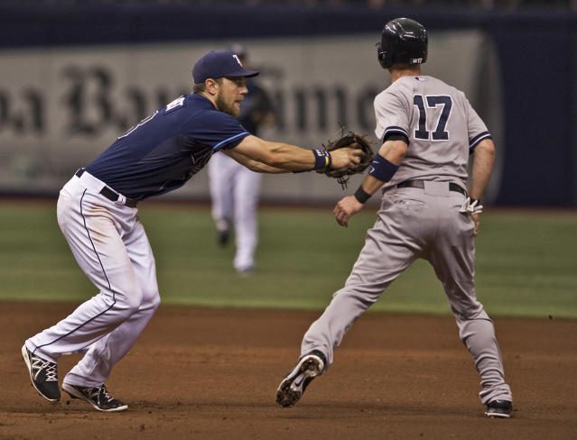 Tampa Bay Rays' Ben Zobrist, left, tags out Brendan Ryan (17) who was caught in a rundown while trying to steal second base during the fifth inning of a baseball game Saturday, Aug. 16, 2014, in St. Petersburg, Fla. (AP Photo/Steve Nesius)