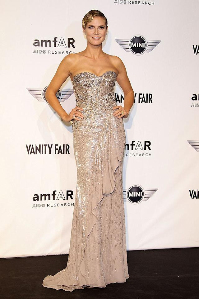 """Heidi Klum was dressed to impress -- in something other than one of her usual minis -- for the 2010 amfAR Milano charity fete. The """"Project Runway"""" hostess with the mostest made a bold statement in a beautifully embellished Cavalli gown, diamond accessories, and a fab finger wave. Vittorio Zunino Celotto/<a href=""""http://www.gettyimages.com/"""" target=""""new"""">GettyImages.com</a> - September 27, 2010"""