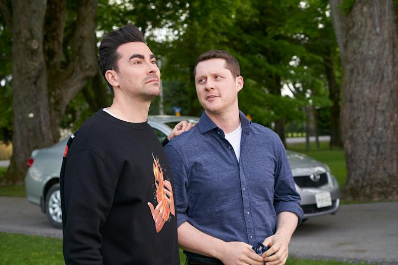 Dan Levy as David Rose (left) and his onscreen love Noah Reid, who portrays Patrick Brewer.
