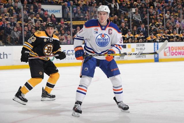 "Art Ross contenders <a class=""link rapid-noclick-resp"" href=""/nhl/players/6743/"" data-ylk=""slk:Connor McDavid"">Connor McDavid</a> and <a class=""link rapid-noclick-resp"" href=""/nhl/players/4351/"" data-ylk=""slk:Brad Marchand"">Brad Marchand</a> went head-to-head in a game with playoff implications for their teams. (Photo by Steve Babineau/NHLI via Getty Images)"