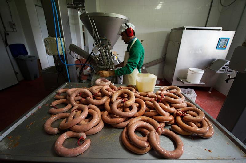 DELEITOSA, SPAIN - OCTOBER 29: A worker prepares traditional chorizo sausages at the small family-run 'Sierra de las Villuercas' processing plant on October 29, 2015 in the village of Deleitosa, in Extramadura province, Spain. The Spanish meat processing industry, which employs over 110,000 people, has been alarmed by the recent World Health Organization's announcement linking cancer to red meats and particularily processed meats like sausages. (Photo by Denis Doyle/Getty Images)