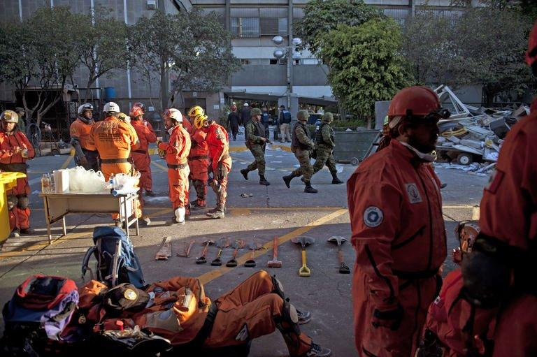 A rescue member takes a break from the search for victims at the headquarters of state-owned Mexican oil giant Pemex in Mexico City on February 1, 2013