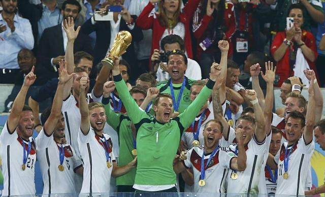 Germany's goalkeeper Manuel Neuer lifts the World Cup trophy after the 2014 World Cup final against Argentina at the Maracana stadium in Rio de Janeiro July 13, 2014. REUTERS/Eddie Keogh (BRAZIL - Tags: SOCCER SPORT WORLD CUP)