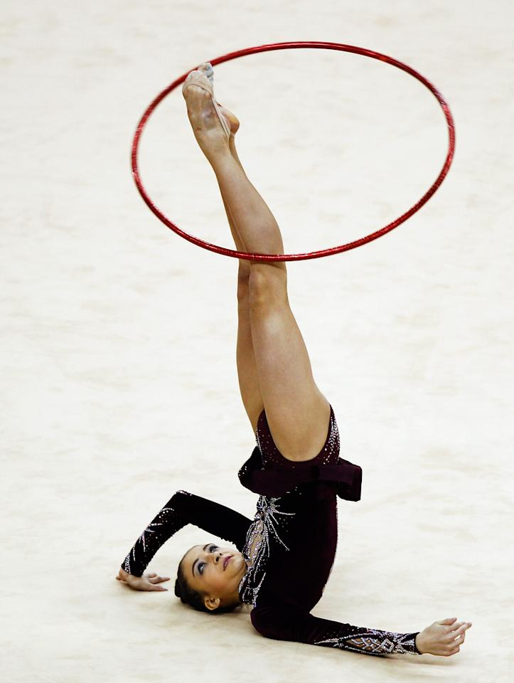 LONDON, ENGLAND - JANUARY 18:  Jana Berezko-Marggrander of Germany in action in the Individual All-Around during the FIG Rhythmic Gymnastics Olympic Qualification round at North Greenwich Arena on January 18, 2012 in London, England.  (Photo by Paul Gilham/Getty Images)